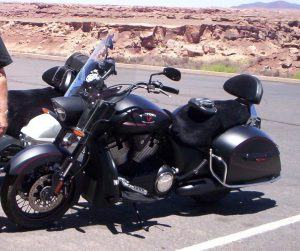 Short wool sheepskin with straps on a Victory motorcycle